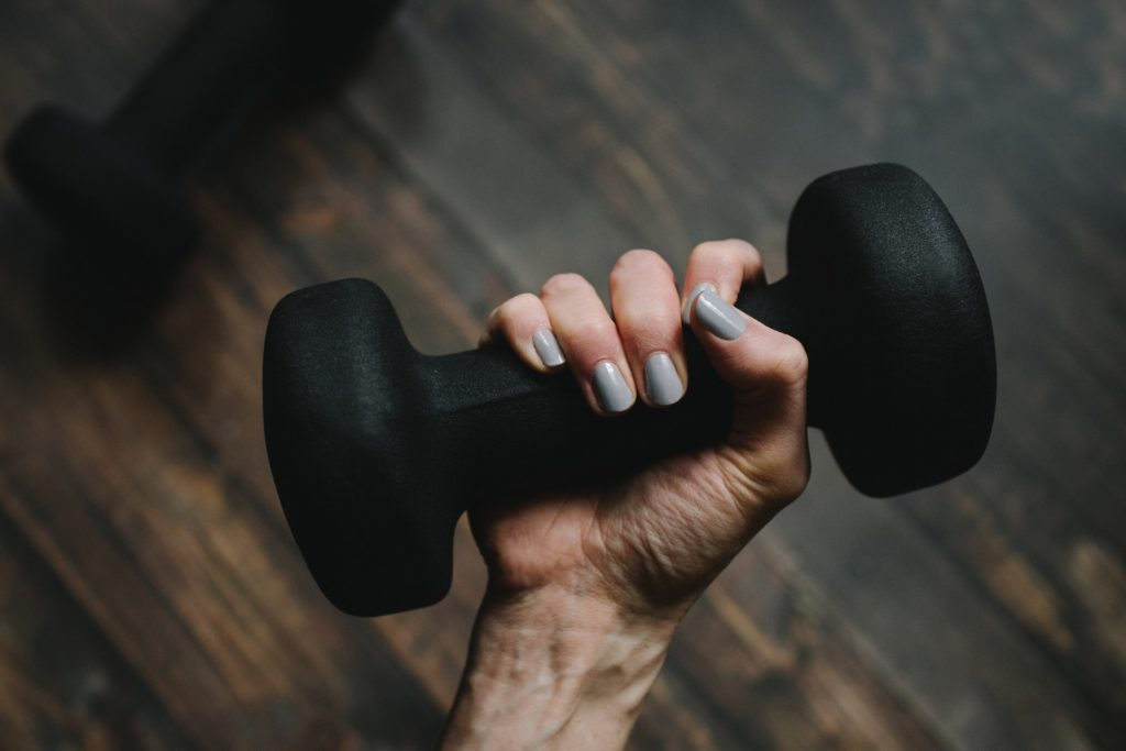 A hand gripping a dumbbell